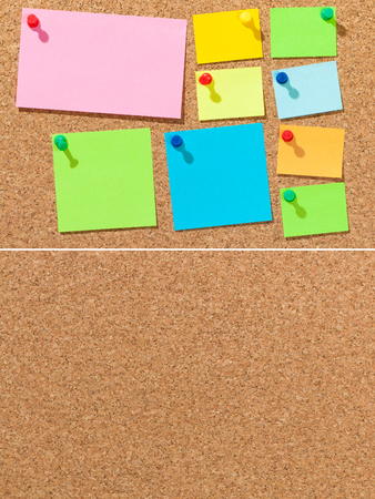 Colored sheets of paper on cork board for background; Pieces of paper in different sizes for memos and notes on brown background; Pin board Standard-Bild