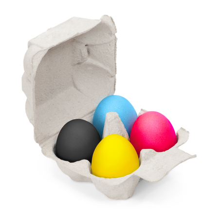 Four eggs painted in cmyk colors in bright egg carton against white background; Colored hen's eggs in cardboard box; Easter promotion; Printing colors Standard-Bild