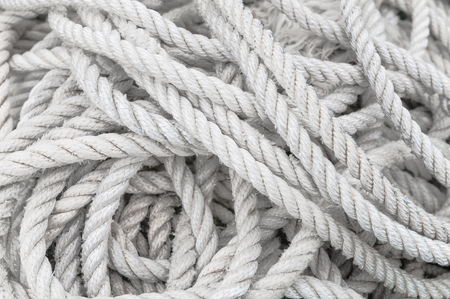 Long, disordered, twisted white rope; Symbol for challenge, trial of patience, solution search, confusion