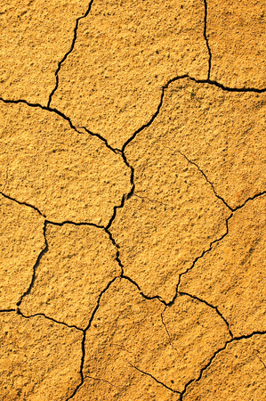 Parched earth with cracks - top view - for background or texture; Severe drought; Water shortage; Climatic catastrophe Standard-Bild