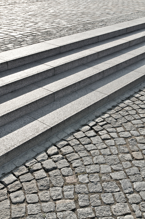 Wide staircase with four steps in pedestrian area with cobblestones - upright format; Floor design on public space; Bridging of height differences Standard-Bild
