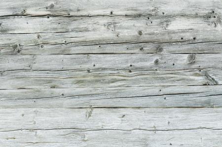 背景やテクスチャのための灰色、天候に打たれた木製の壁。グランジ木製ボード。木製表面 写真素材