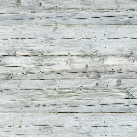 Gray wooden wall - square format - for background and texture; Weathered and faded wooden boards; Cracked wooden surface