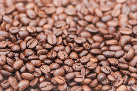 Dark brown, roasted coffee beans closeup for background; Important commodity; Processed seeds of the coffee plant; Roast coffee