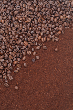 Whole, roasted coffee beans and ground coffee - closeup, topview and upright format; Important import product; Processed coffee beans Imagens