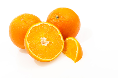 Juicy oranges on white background; Whole, halved and quartered orange; Citrus fruits; Fresh ingredient for juices, cocktails, sweet desserts or marmalade