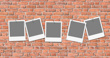 Five empty picture frames on grunge red brick wall; Seamless background of old masonry; Insert your favorite snapshots; Instant picture frames Standard-Bild