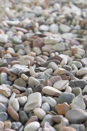 Gravel in different sizes and colors - upright format; easy-care floor covering in the garden; Coarse gravel surface