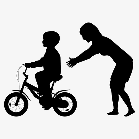teaches: Mother teaches a child to ride a bike silhouette Stock Photo