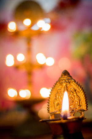 Oil lamp with blured background in indian setup photo