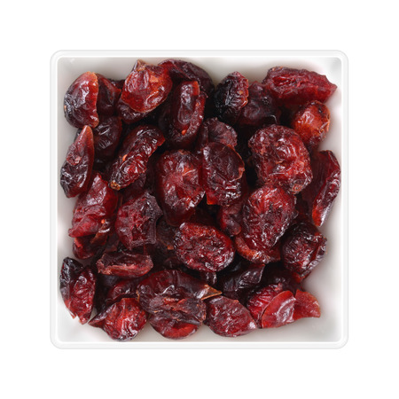 Dried cranberries in square bowl on white background