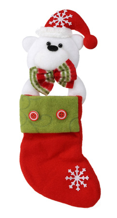 Christmas sock with polar bear isolated on white background. Stock Photo