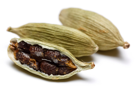 Green cardamom pods and seeds isolated on white background 写真素材