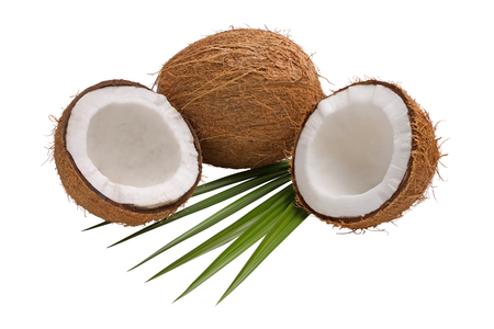 Fresh coconut broken in half with leaves isolated on white background