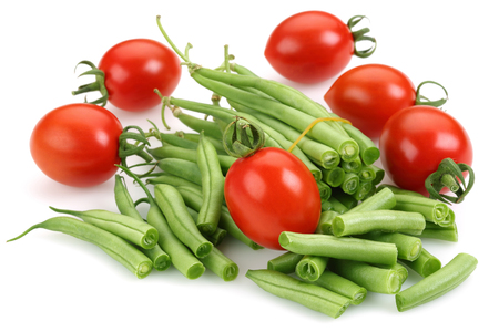 Fresh green beans and tomatoes isolated on white background