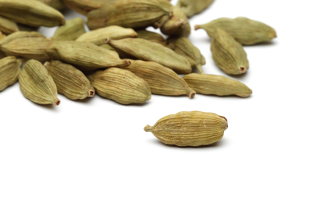 Dry cardamom pods isolated on white background