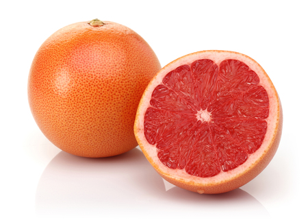 Fresh grapefruit with half isolated on white background