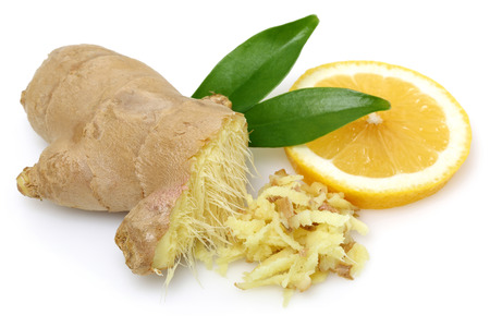 Fresh ginger root with leaves and lemon isolated on white background