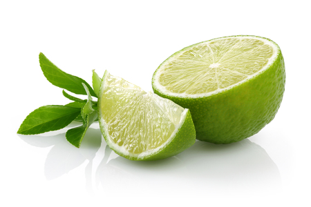 Sliced fresh lime fruits with leaves isolated on white background