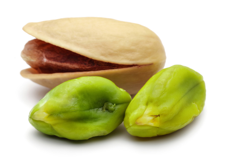 Peeled and whole pistachio nuts isolated on white background 免版税图像