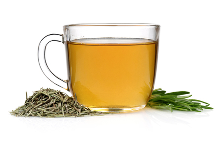 Tea Cup between dried and fresh rosemary isolated on white background