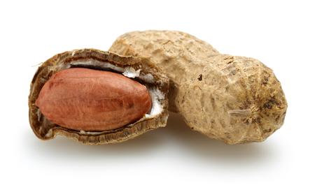 Peanuts isolated on white background, macro shot Reklamní fotografie