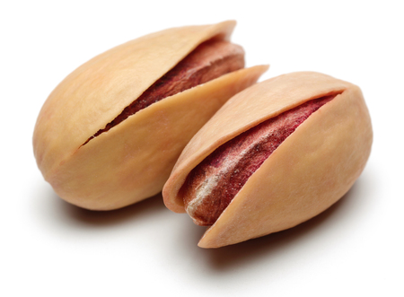 Fresh pistachio nuts isolated on white background