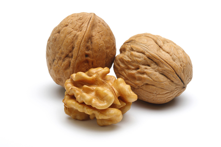 Walnuts and cracked walnut isolated on white background