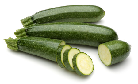 Green zucchini with slices isolated on white background