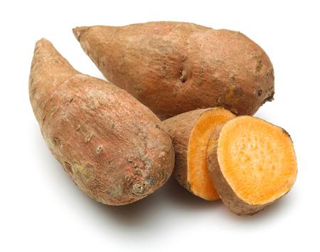 Raw sweet potato with slice isolated on white background