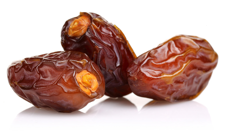 Date fruits isolated on white background. Studio shot. 免版税图像