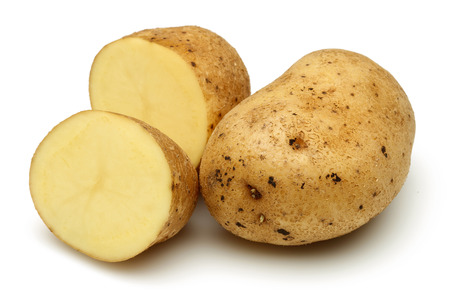 Fresh potatoes with slices isolated on white background Reklamní fotografie