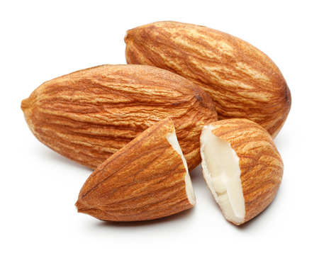 Heap of almonds isolated on white background Stock Photo - 121143567