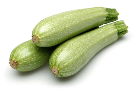 Group of green zucchini isolated on white background
