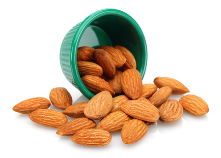 Almonds in the bowl isolated on white background