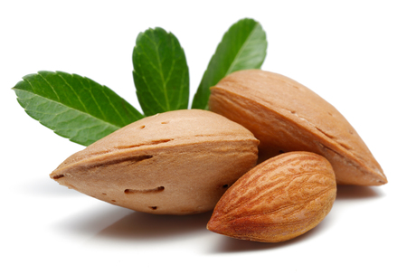 Almonds with leaves isolated on white background