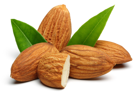 Group of almonds with leaves isolated on white background Stock Photo