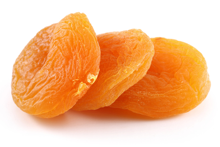 Dried apricots isolated on white background. Studio shot