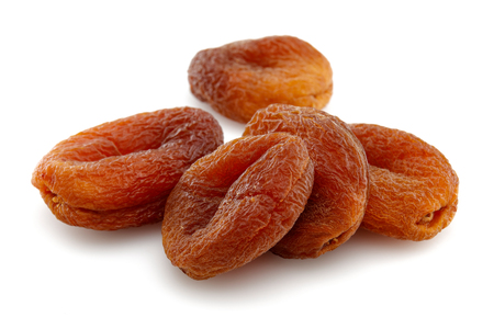 Organic dried apricots isolated on white background. Studio shot