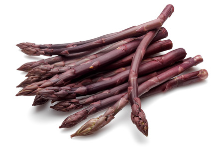 Purple asparagus sticks isolated on white background