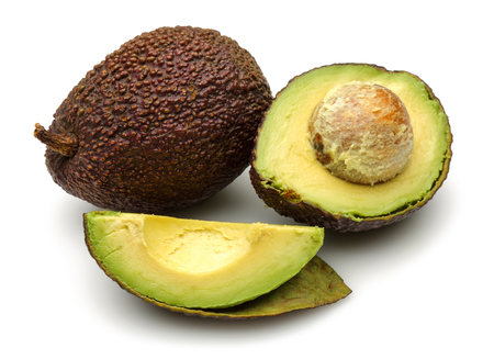 Fresh ripe avocado with slices isolated on white background