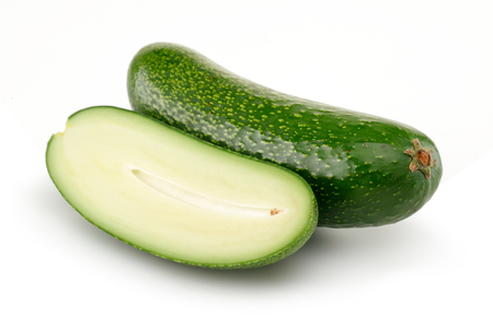 Fresh seedless avocados isolated on white background