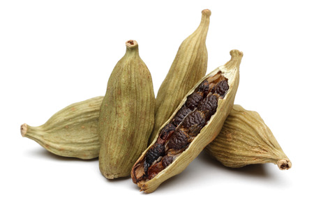 Cardamom pods and seeds isolated on white background Banco de Imagens