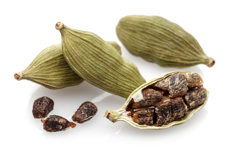 Cardamom pods and seeds isolated on white background 写真素材