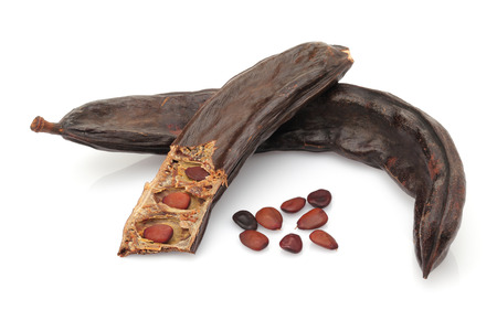 Ripe carob pod with seeds isolated on white background 写真素材
