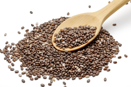 Chia seeds in wooden spoon isolated on white background 写真素材