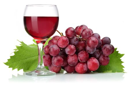 Red grapes and glass of wine with leaves isolated on white background