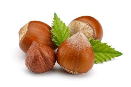 Hazelnut with leaf isolated on white background