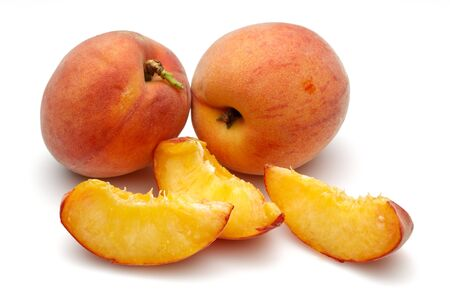 Ripe peach fruits with slices isolated on white background 免版税图像