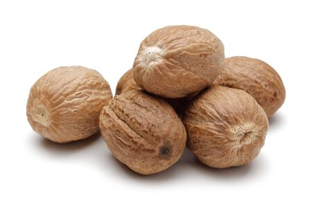 Group of whole nutmegs isolated on white background